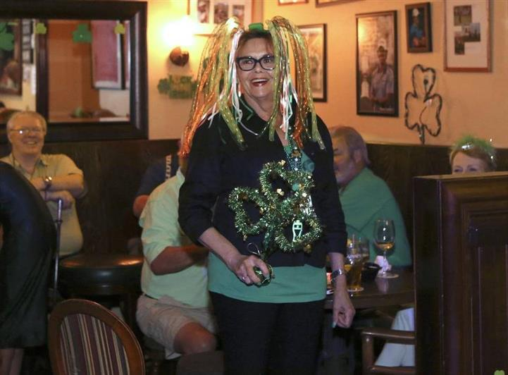 A women dressed in St Patrick's day decor