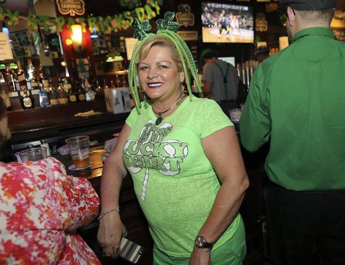 Lady in clover apparel smiling