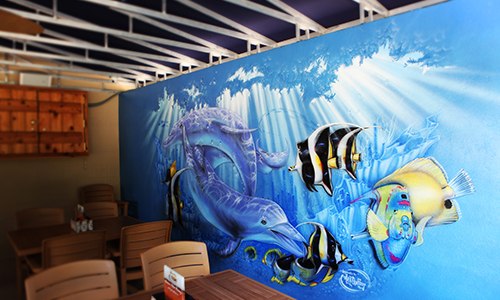 Wall mural of fish and dolphins swimming