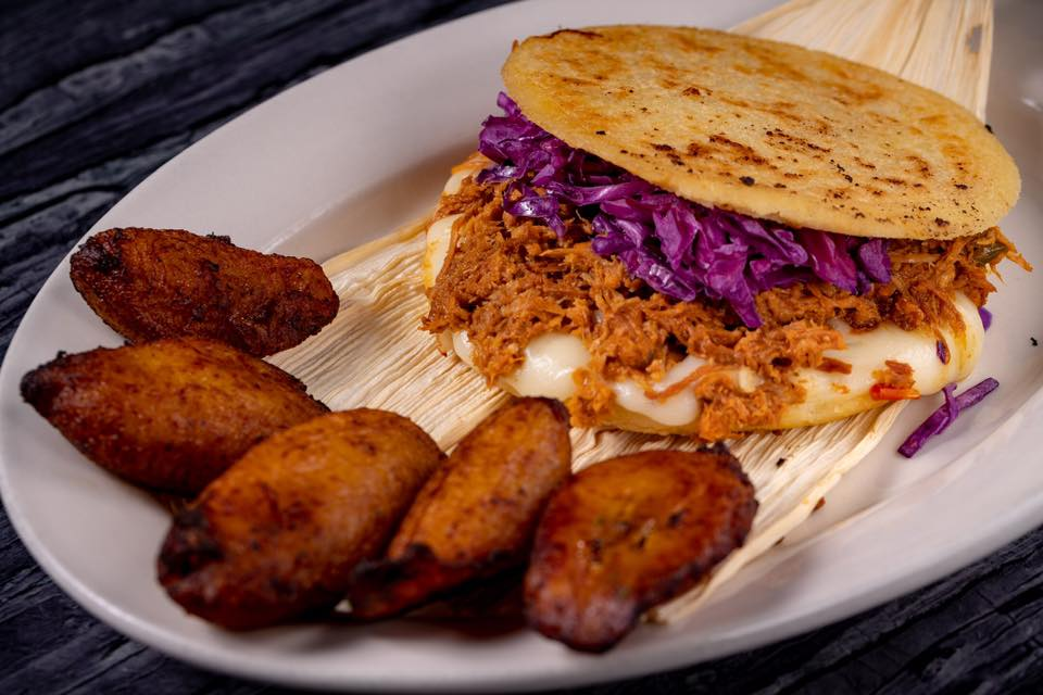Arepas: South American white corn patty stuffed with mozzarella cheese and your choice of shredded beef, chicken or pork topped with red cabbage slaw