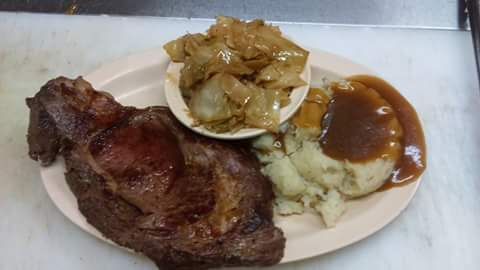Prime Rib with mashed potatoes and one side