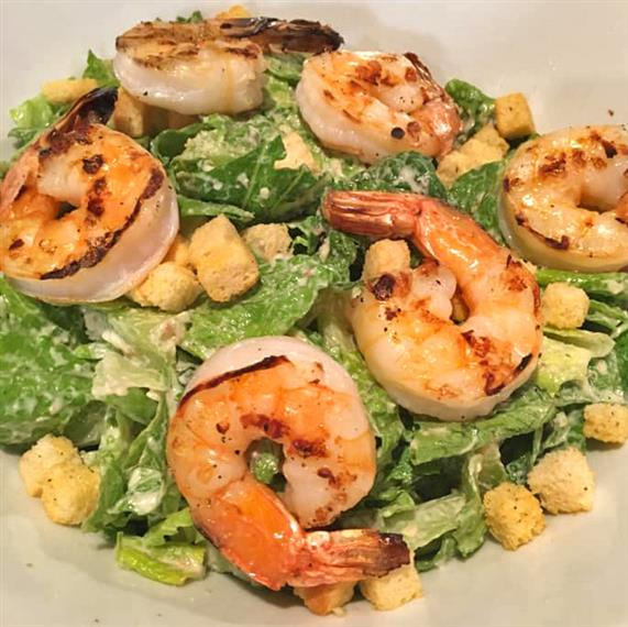 Grilled shrimp caesar salad with croutons