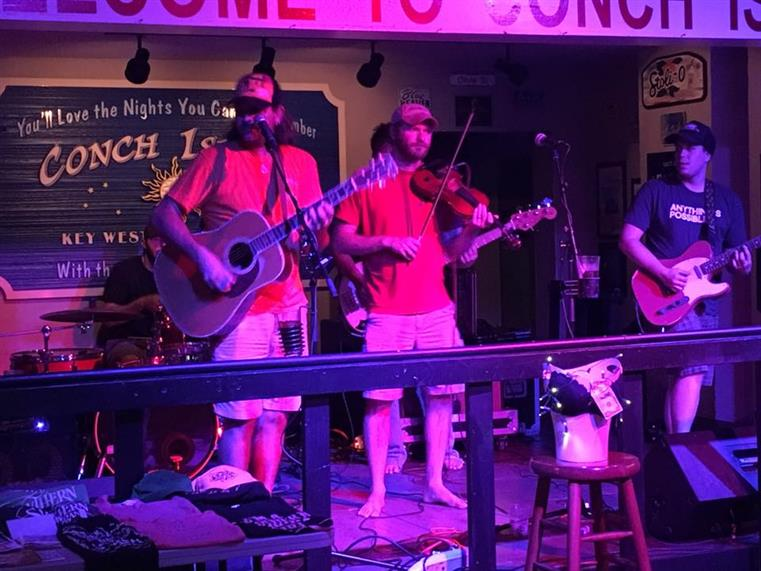 Band performing on stage at Conch Island Key West Bar and Grill