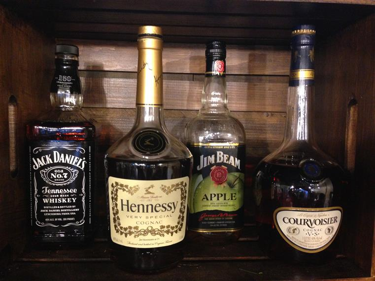 A variety of liquor bottles on a bar counter