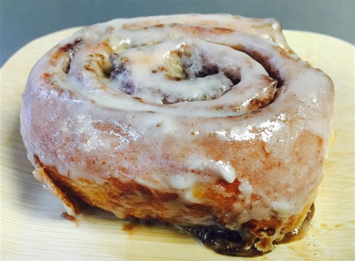 cinnamon roll glazed with powdered sugar