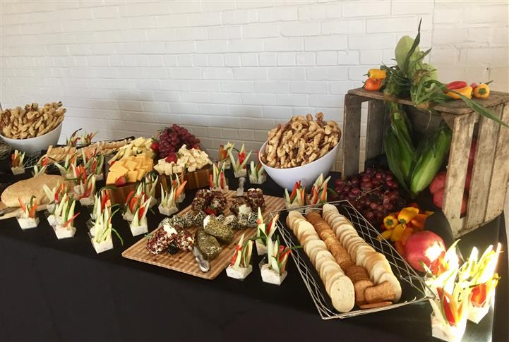 Buffet layout with trays and platters decorated beautifully