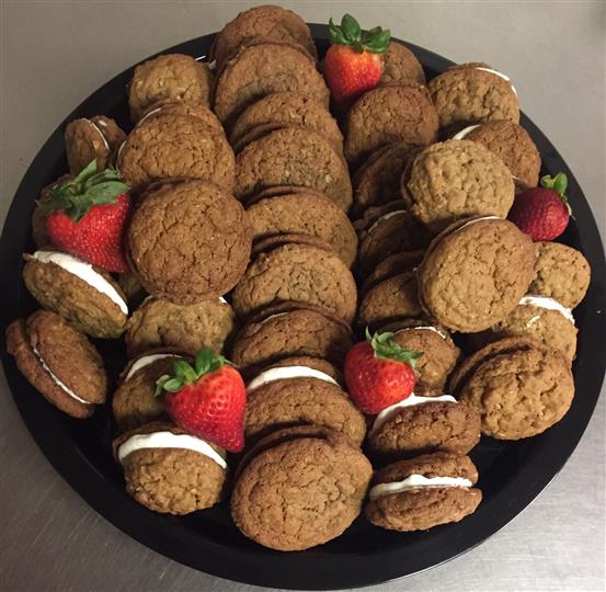 Platter full of stuffed cookies decorated with strawberries