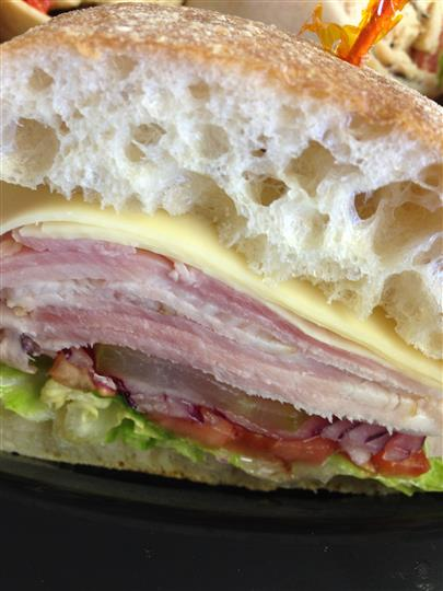 Detail of ham and cheese sandwich with lettuce, onion and tomato