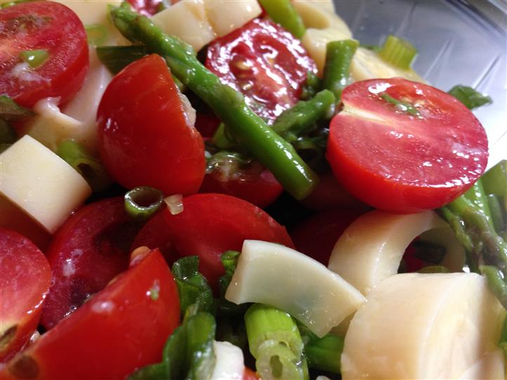 Salad dish with cherry tomatoes, artichoke hearts and other vegetables