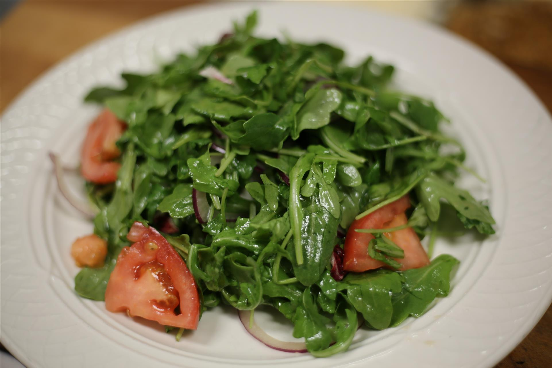 Arugula & Radicchio salad with tomatoes.