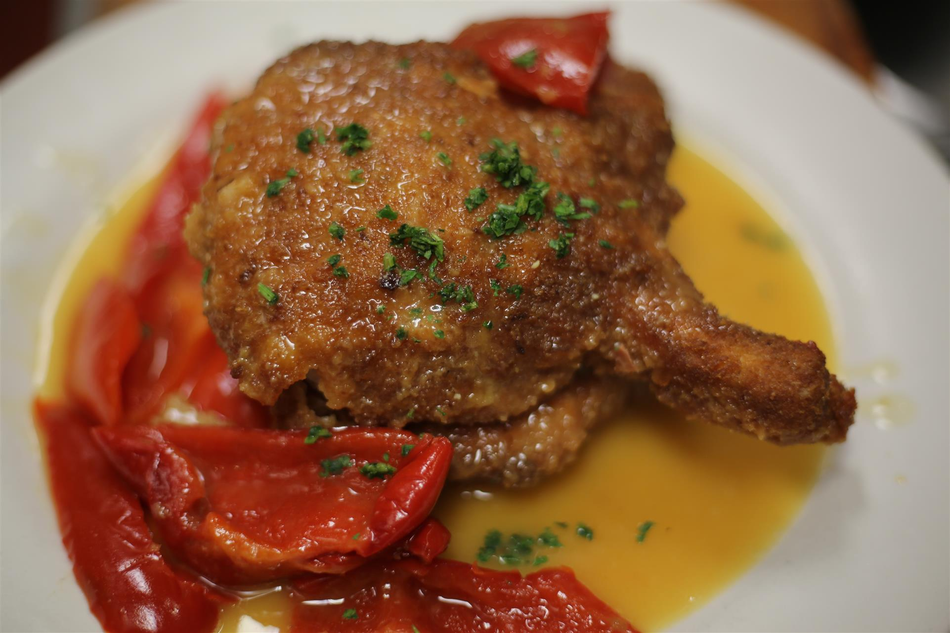 Fried Pork Chop in light sauce with red peppers.
