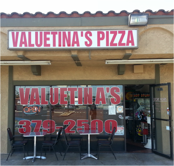 exterior front entrance to valuetina's pizza with chairs and tables out front