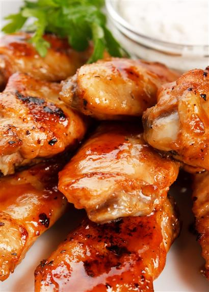 assortment of chicken wings with a side of dipping sauce
