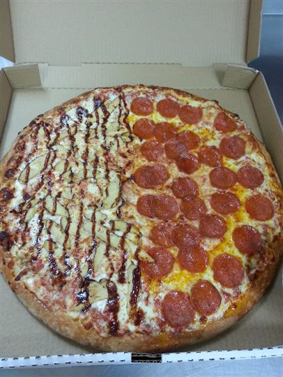 large split pizza with pepperoni on one side and eggplant on the other