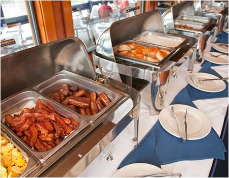 Buffet trays with sausage, bacon, rolls in sternos