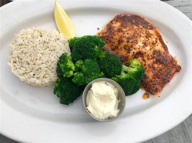 Fish with rice and broccoli