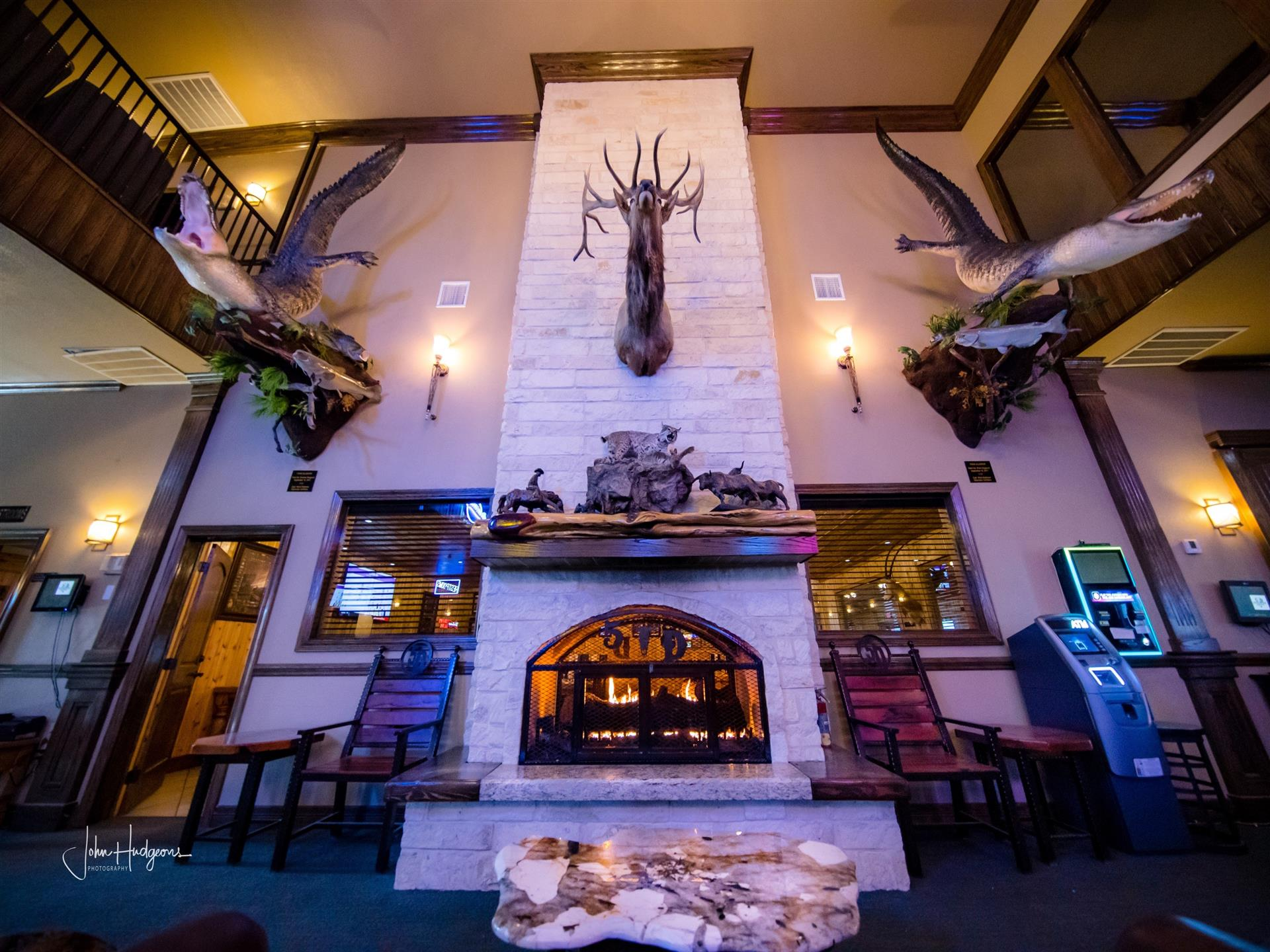 Fire place from floor to ceiling with deer head mounted on top
