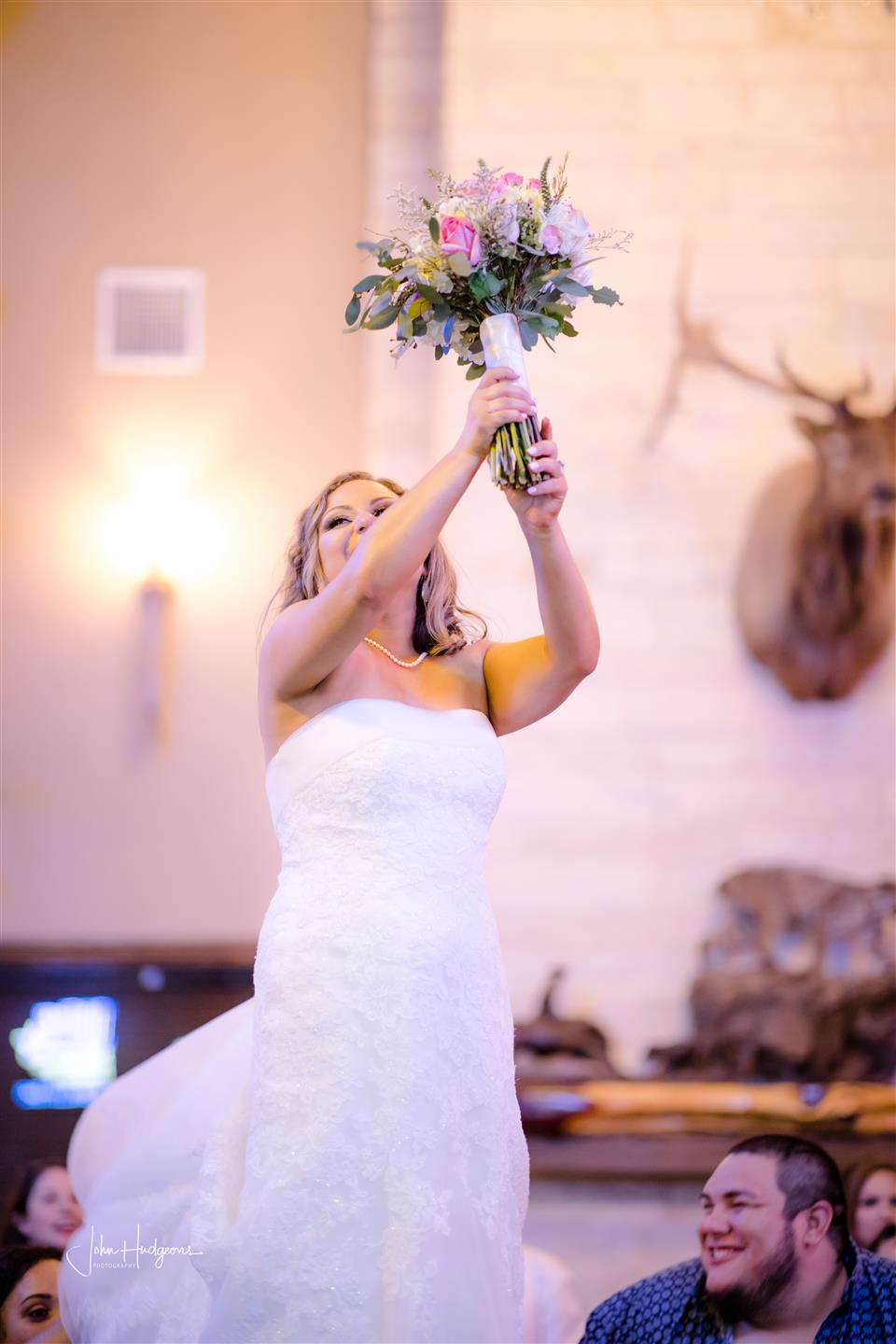 Bride tossing her bouquet