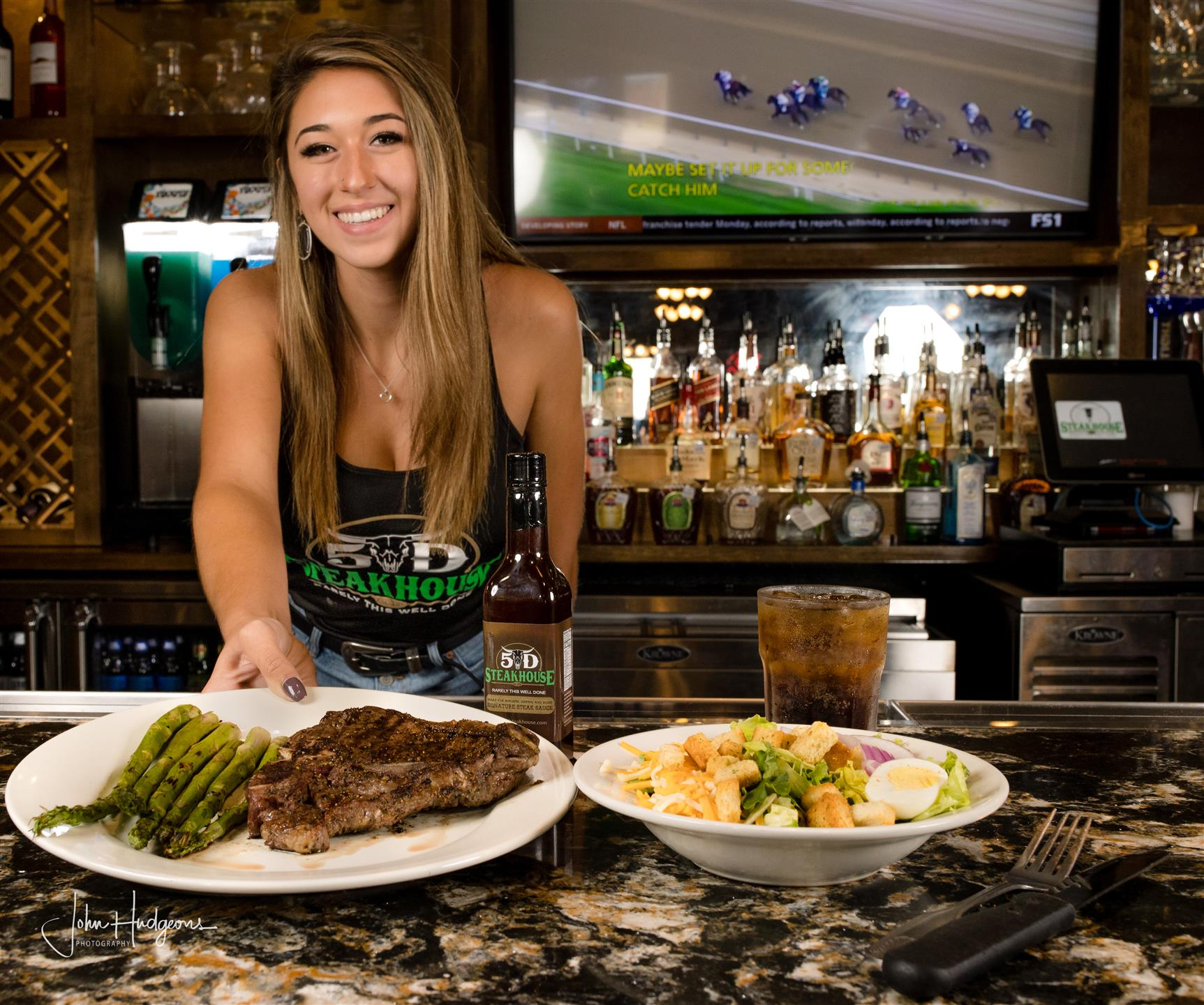 Bartender serving plates of food