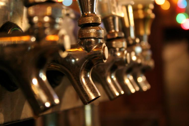 Closeup of gold beer taps