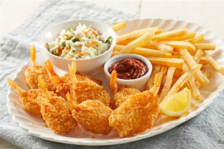 fried shrimp with coleslaw and fries