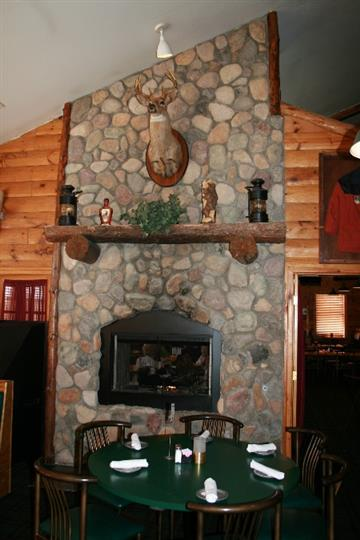 stone fireplace with animal head