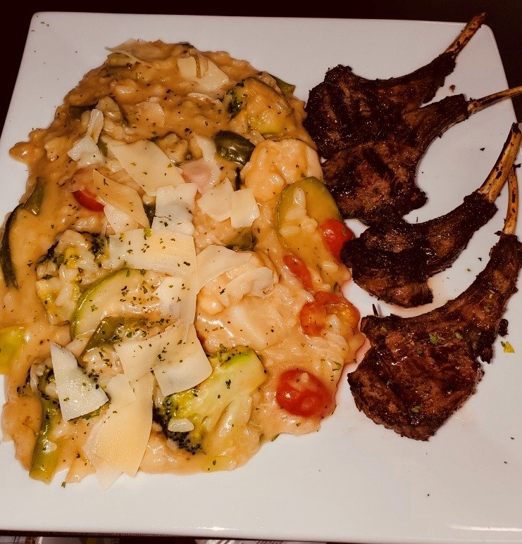 lambchops served with cheese vegetable risotto
