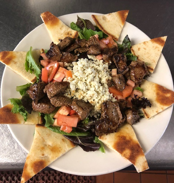 salad with steak and fresh blue cheese crumbles, served with fresh pita