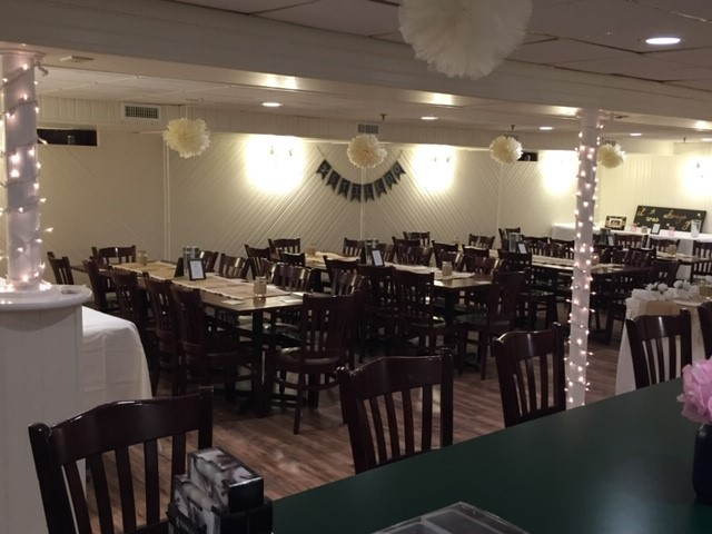 banquet room decorated for an event with string lights and paper lanterns