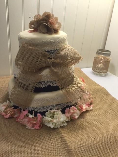 wedding cake decorated with a rustic theme