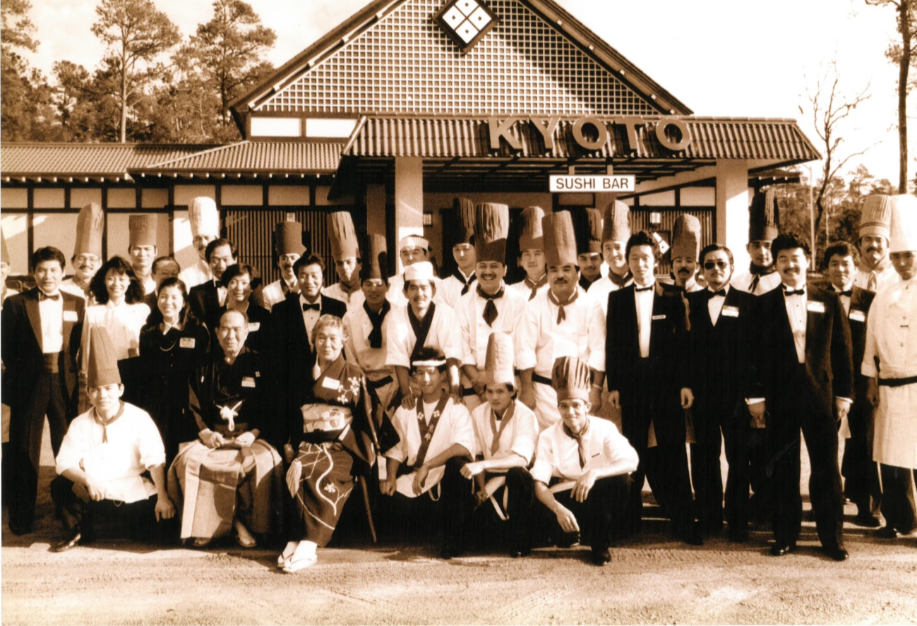 Staff outisde of restaurant posing for group photo