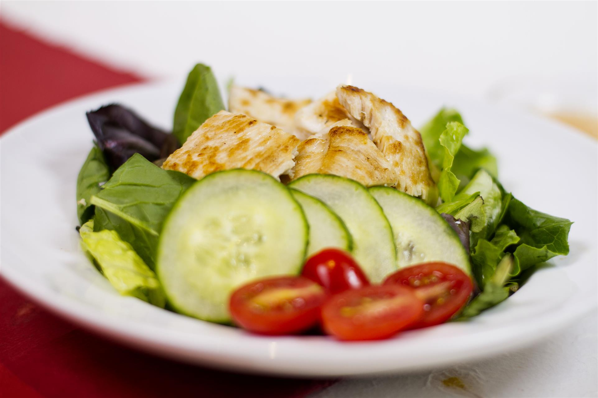small salad with chicken, cucumber and tomatoes