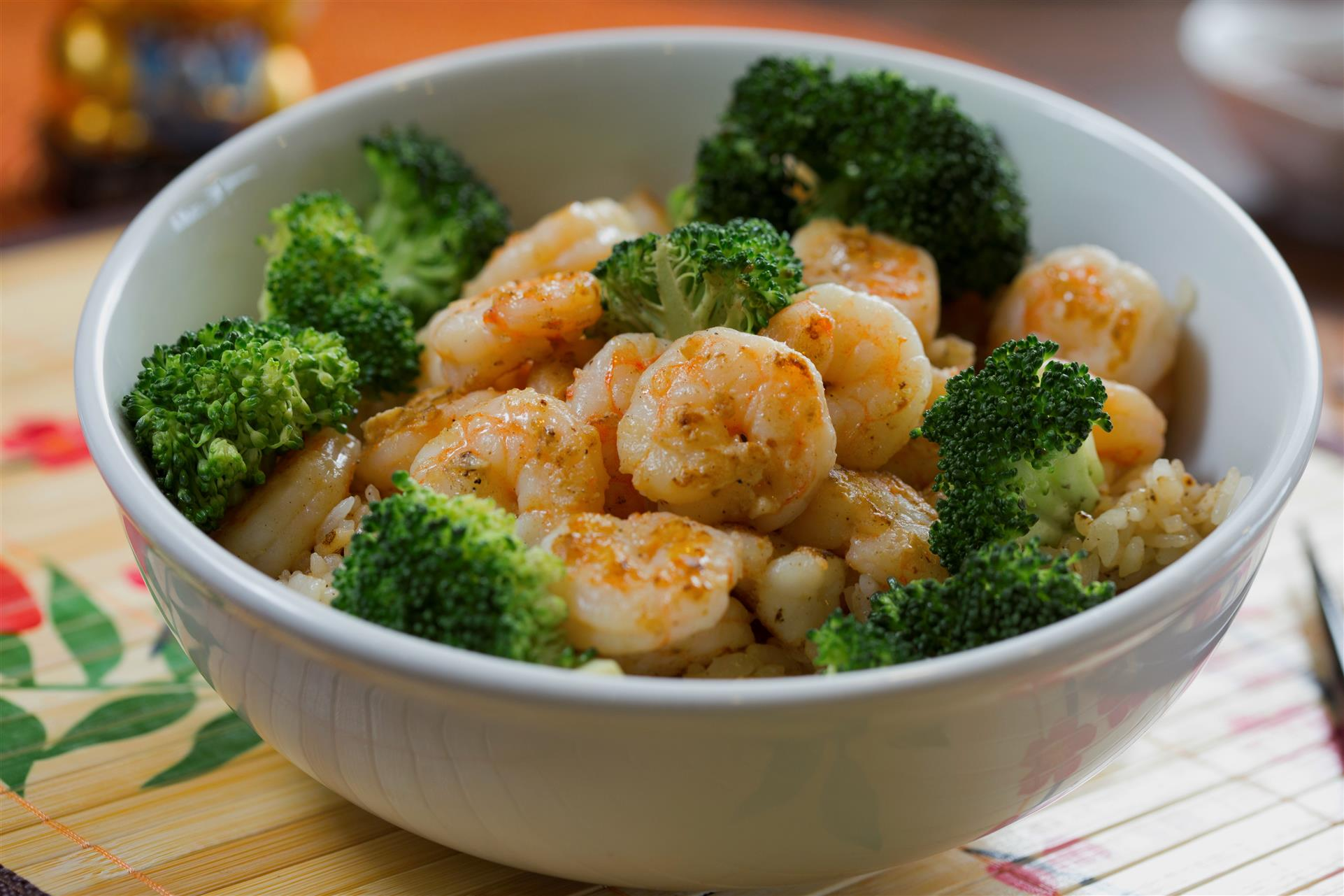 a bowl filled with cooked shrimp and vegetables