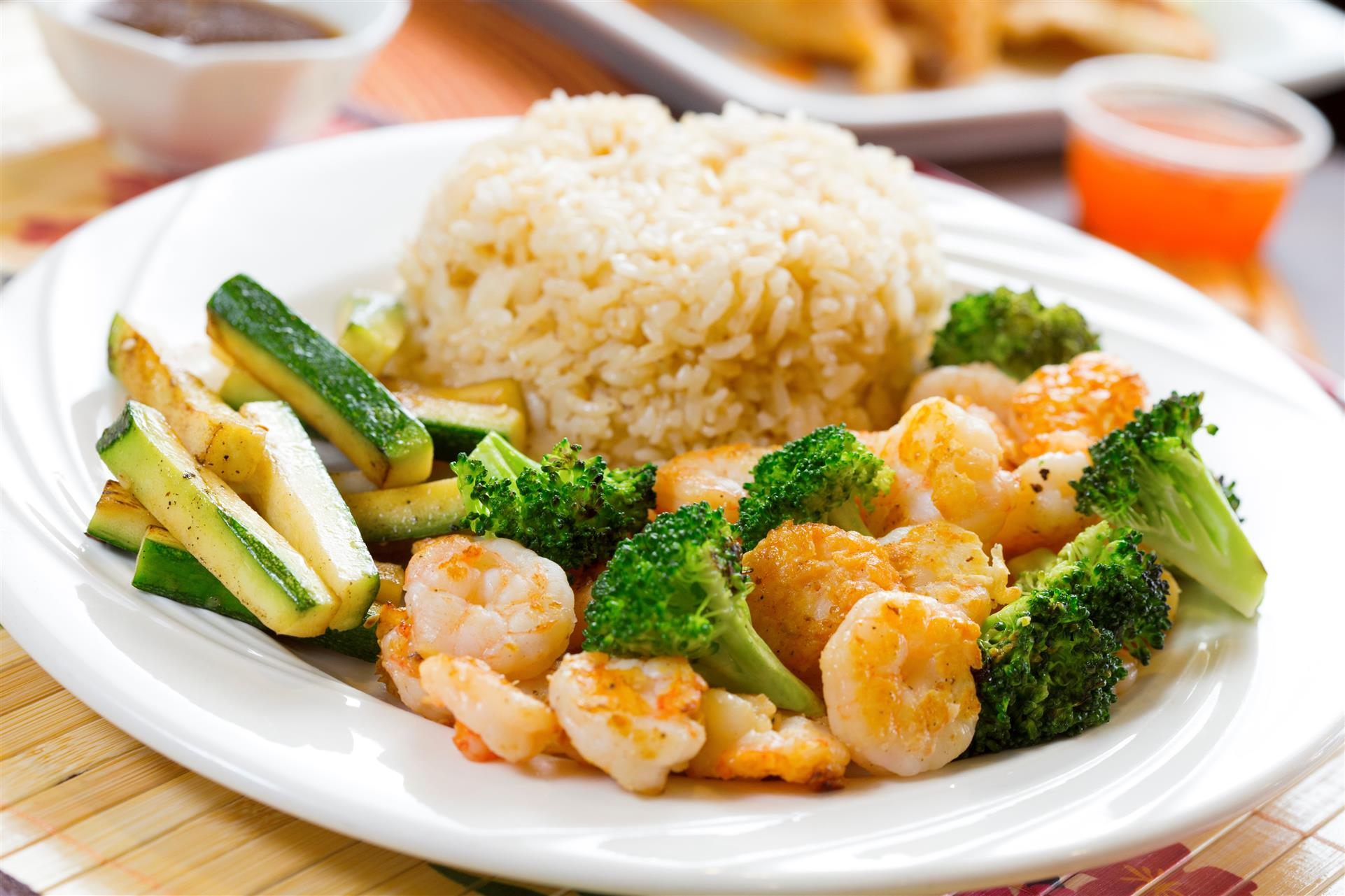 cooked shrimp and vegetables with a side of rice