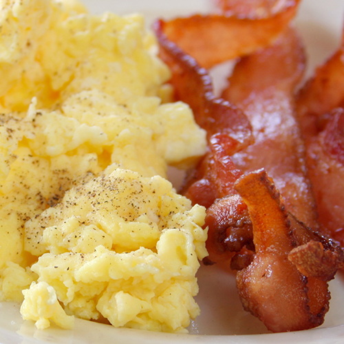 scrambled eggs and bacon strips