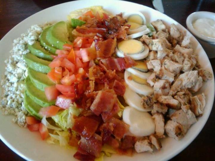 chopped lettuce • diced chicken • bacon • tomato • avocado • hard boiled egg • bleu cheese