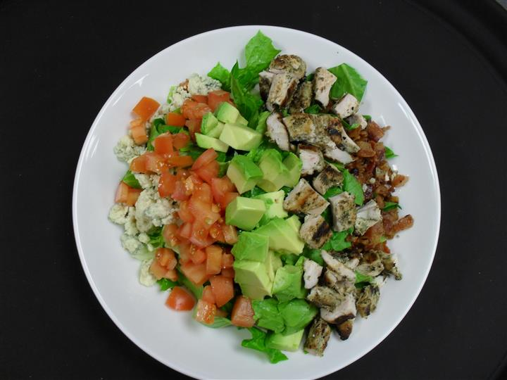 chopped romaine, blue cheese crumbles, tomato, diced avocado, diced chicken and bacon bits