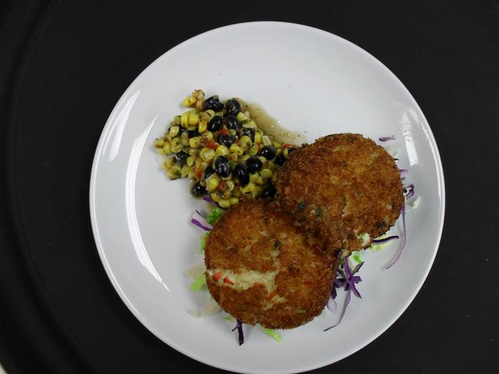 two round balls fried with a side of roasted corn