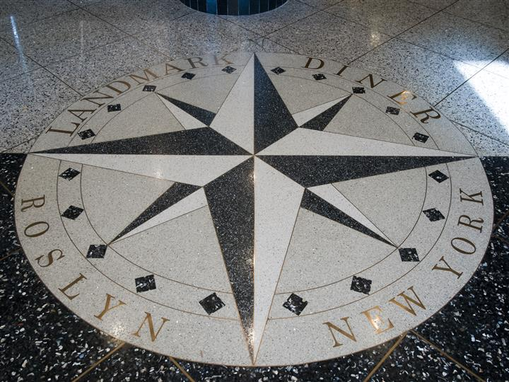 compass design on the floor with Landmark Diner written