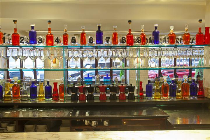 Interior shot of the bar, with bottles of liquers