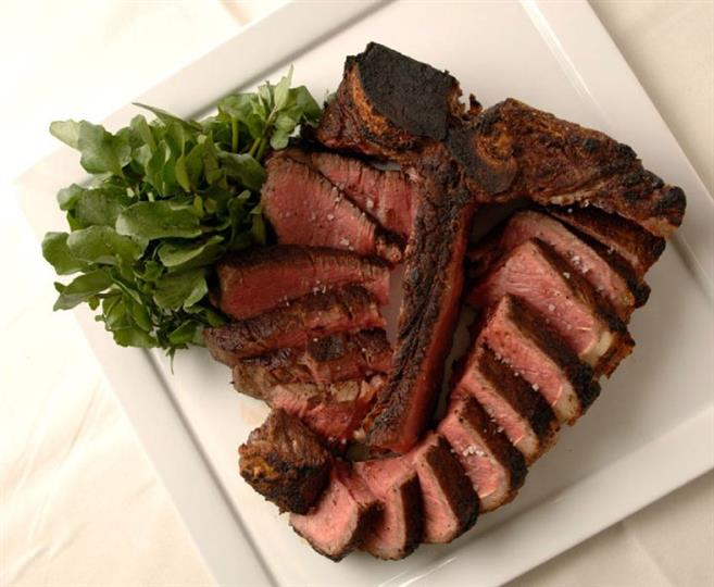 Steak served with arugula
