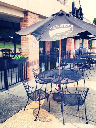 outside dining tables, with umbrellas