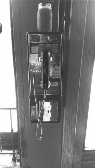 Mason jar on top of payphone