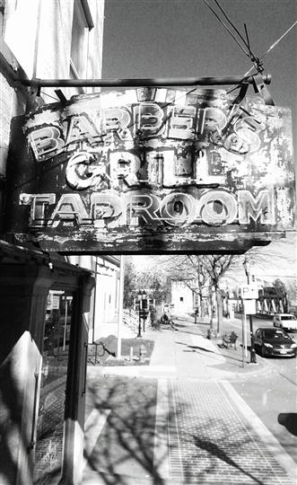 Vintage Barber's Grill Taproom sign