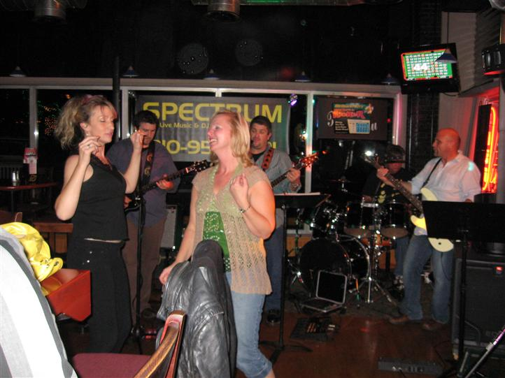 band playing while two females dance