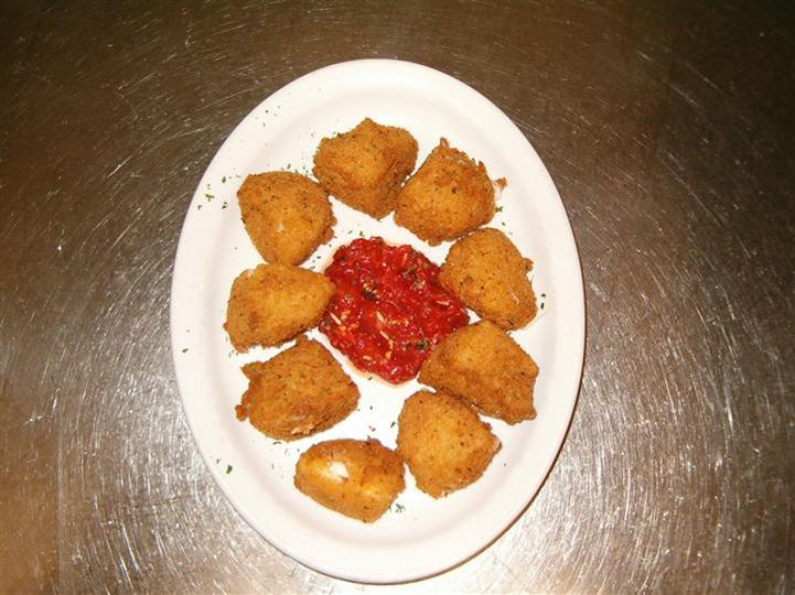 appetizer with dipping sauce on a plate