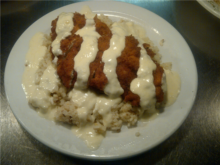 entree over rice on a plate