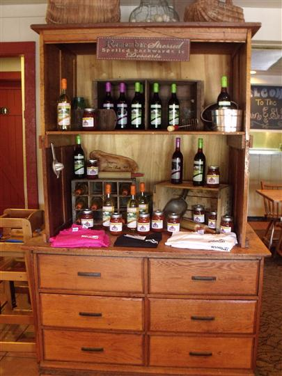 a wooden cabinet with various wine bottles