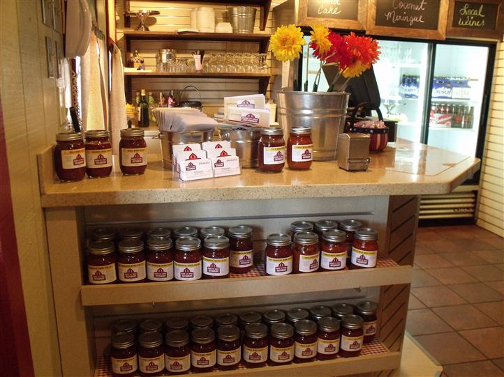 front counter with lots of jars with the Barn and Gril label