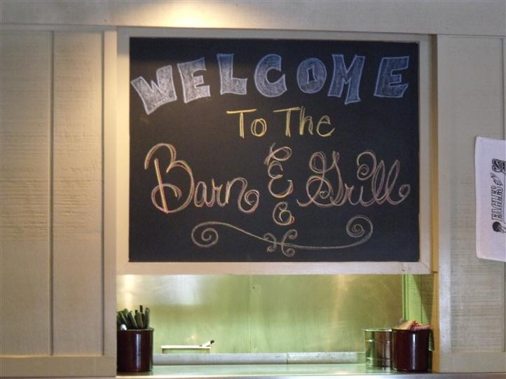 """Welcome to Barn and Grill"" written on a chalkboard"